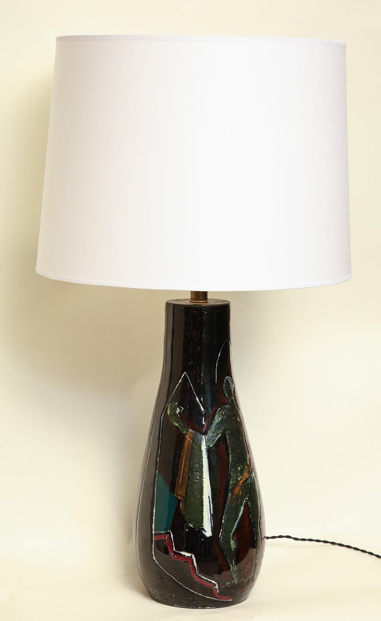 A ceramic table lamp signed Art Rumi Milano Italy decorated with abstract man