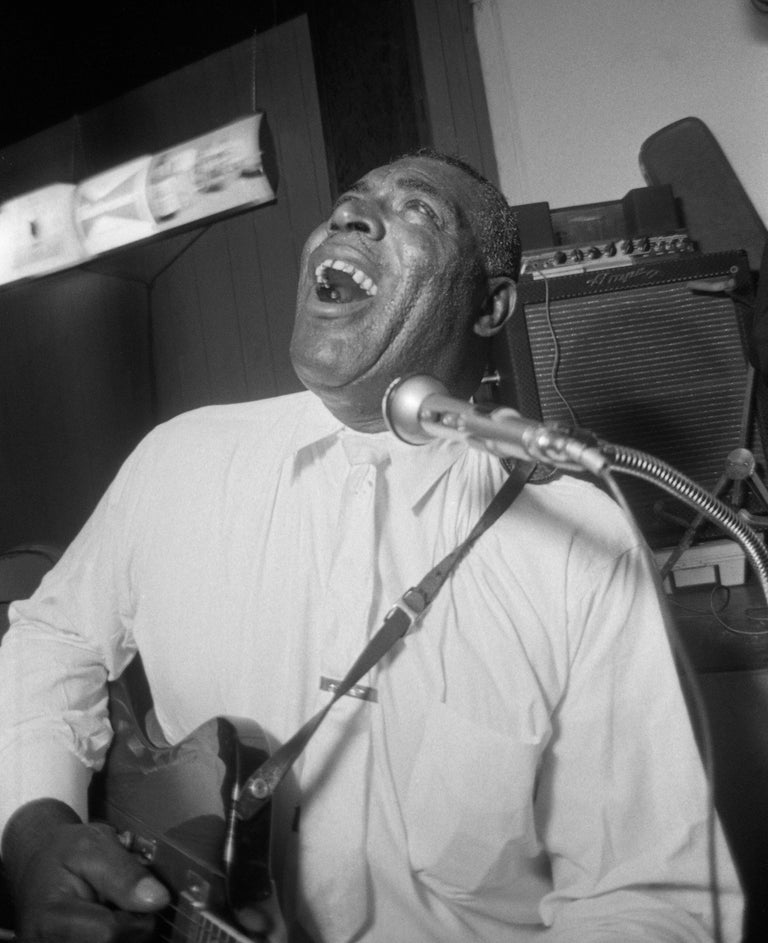 Howlin' Wolf was one of blues music's all-time greats, known for his electric guitar-based style.  Photographed here in 1966 by Art Shay, this black and white image is signed on the bottom right corner.  It is matted and framed, measuring 27.5h x