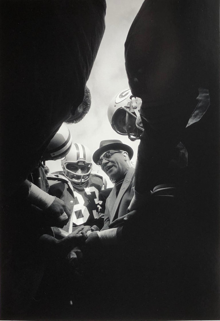 Famed Green Bay Packer coach Vince Lombardi photographed at Lambeau Field in 1966 by Art Shay.  The angle of this shot is particularly interesting.  Art was definitely up close and personal with the coach and players that day!  This photograph is