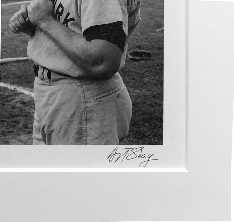 Iconic baseball stars Mickey Mantel and Roger Maris share the stage in this 1961 photograph by Art Shay.  The NY Yankees vs the Chicago White Sox at what was then Comisky Park.  The photograph is signed in the bottom right hand corner.  It is matted