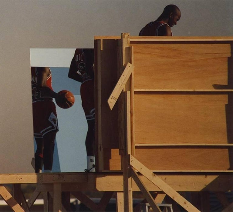 The 1998 photograph of the iconic Michael Jordan was taken by Art Shay during a studio shoot for Sports Illustrated.  It is signed on the back of the photo.  The framer has added a viewing window so that the signature is visible from the back.  Art
