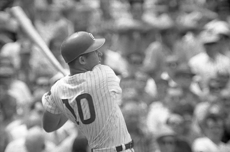 Ron Santo, the third baseman for the Chicago Cubs for 14 out of his 15 year career, is pictured here in this quintessential 1967 black and white photograph.  It is signed by Art Shay on the bottom right hand corner.  The photo is matted and framed