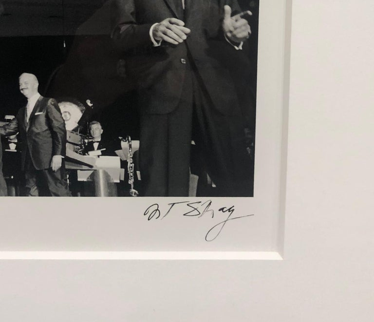 The Rat Pack, performing at the Sands Hotel in Las Vegas in the 1960s was captured by Art Shay in this iconic photograph.  It is signed on the front in the lower right hand corner as well as on the back with the inscription