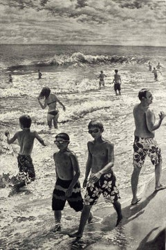 Tidal Shift # 1 (Young bathers stroll on beach with others out in surf Montauk)