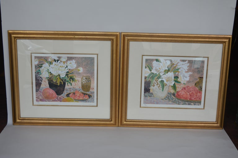 To lithographs of flowers by Allen Gunn. Each signed, dated, and numbered. 22/300 125/300 numbered on the left corner and signed on the right.