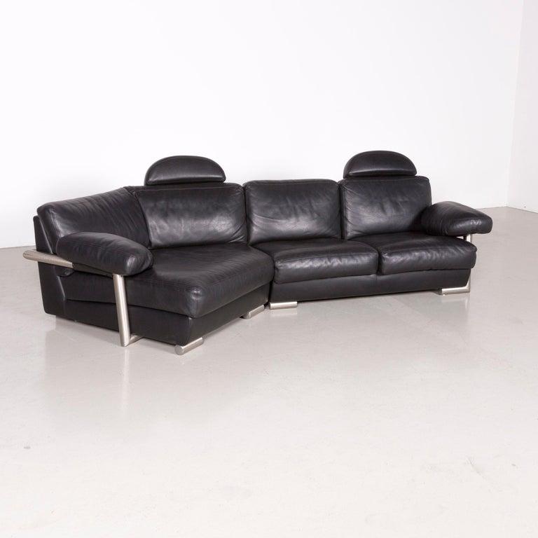 We bring to you an Artanova Medea designer black leather corner sofa.