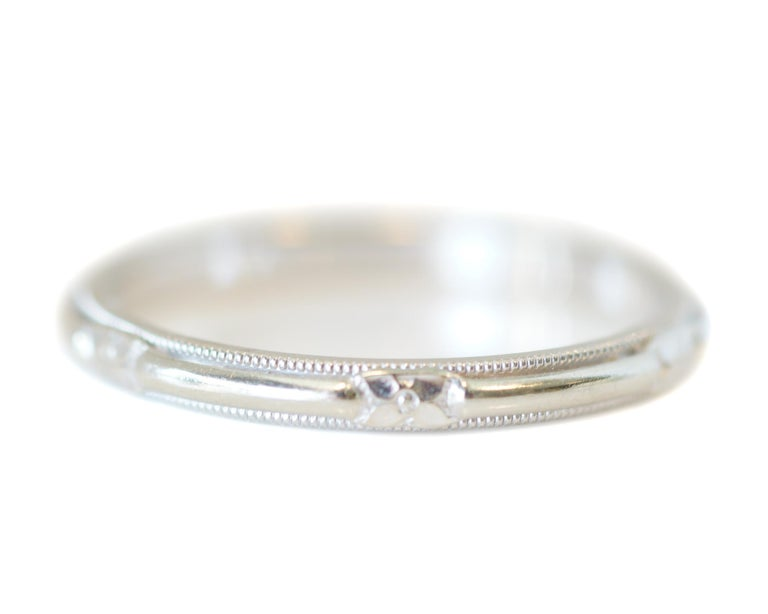 Here we have a classic, elegant, and simple style wedding band. Crafted in 14k white gold, with a visible hallmark inside the shank... this beauty is all antique-charm! Belonging to circa 1930s, on the tail end of art-deco era... it features lovely