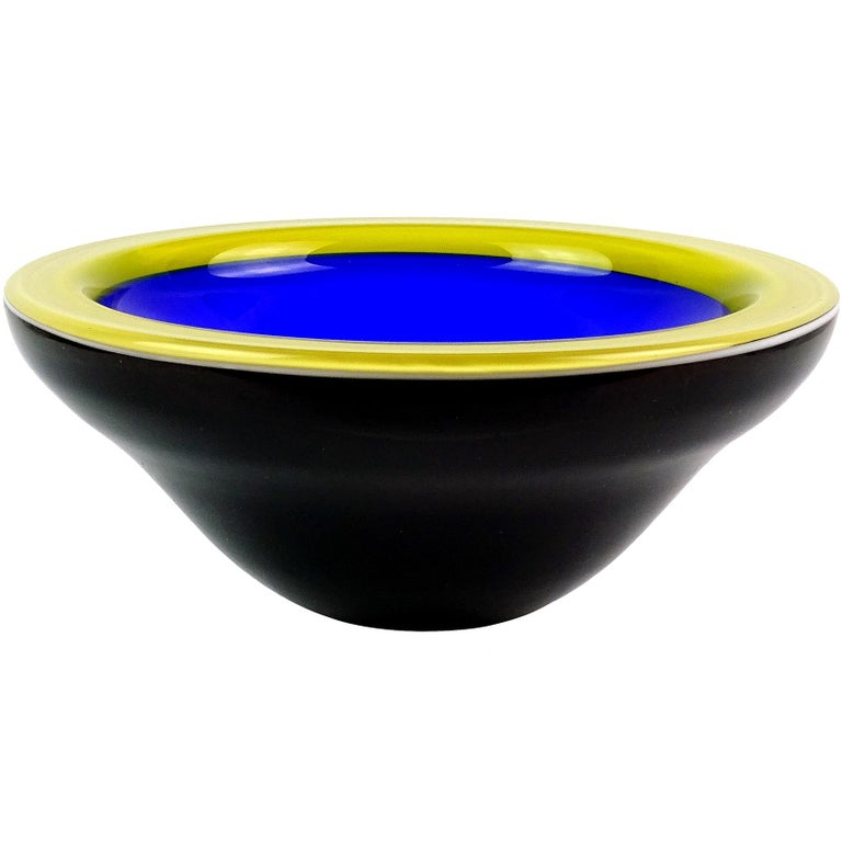 Beautiful vintage ICET Arte Murano hand blown rich cobalt blue, yellow and black art glass bowl. Signed underneath. Made in Venezuela, but crated in the manner of the Italian Murano workshops. The bowl is very deep, with a gorgeous contrasting color