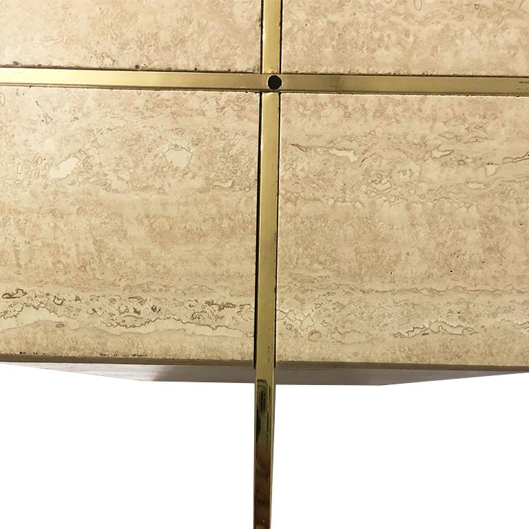 Italian made Travertine base and glass top side or occasional table by Artedi. This table features a square travertine base, satin brass cross X piece which supports a beveled glass tabletop. A wonderful piece for a side table or cocktail table.