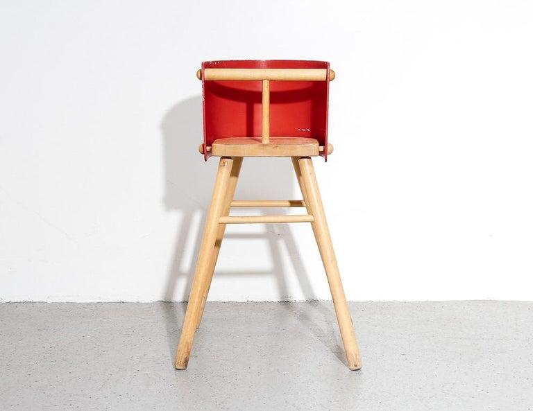 Vintage '616' child's high chair designed by Ben af Schulten for Artek, 1960s. Red painted molded plywood back, birch dowel construction.  22