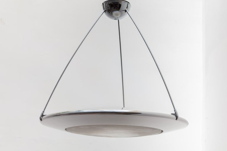 Vintage midcentury Arteluce saucer lamp.This Mira C Suspension provides diffused upward and downward light and features aluminum chrome lamp body finish a sandblasted, acid-etched glass diffuser.  Body is supported by three chrome rods which in