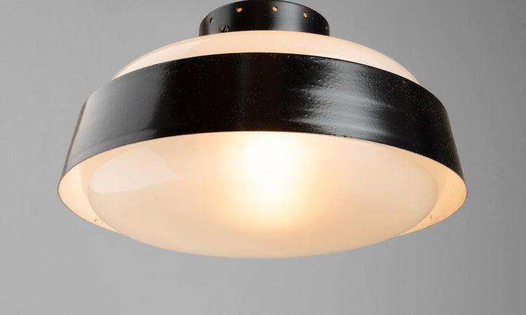 Model 3010, satin glass and aluminum lamp designed by Gino Sarfatti.