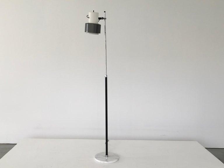 Arteluce floor lamp in grey and white. Adjustable and versatile.