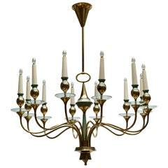 Arteluce Style Twelve Arm Chandelier in Brass and Glass, 1950s