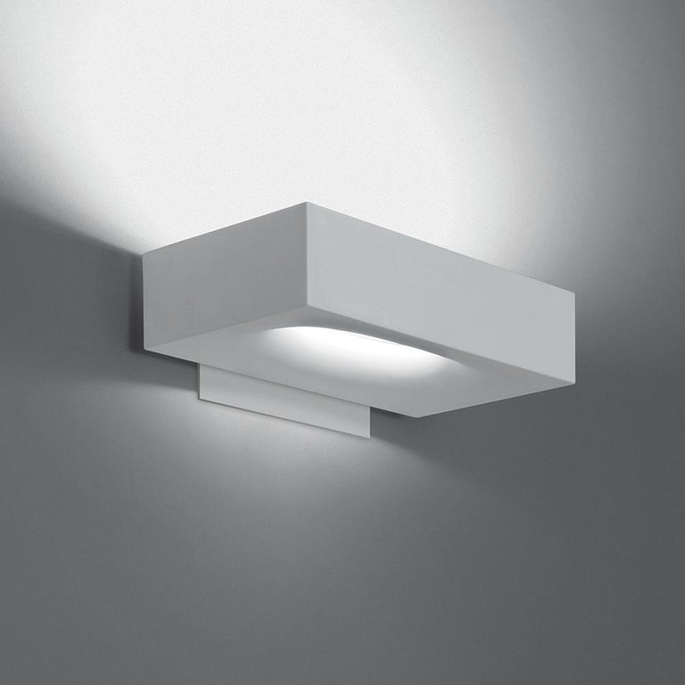 A compact wall-mounted Luminaire for direct and indirect lighting. Die-cast aluminum white painted body. This item is currently only available in North America.
