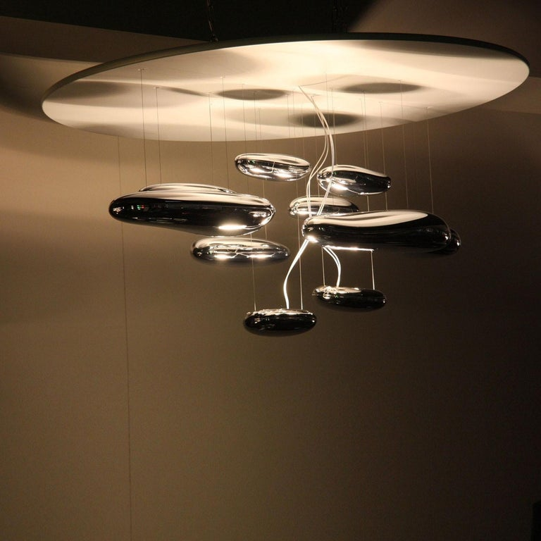 """A """"floating"""" assembly of pebbles, Ross Lovegrove's Mercury creates a biomorphic relationship between reflected light and its environment.   The Mercury LED ceiling light by Artemide is an ultra-contemporary interior lighting piece that showcases"""