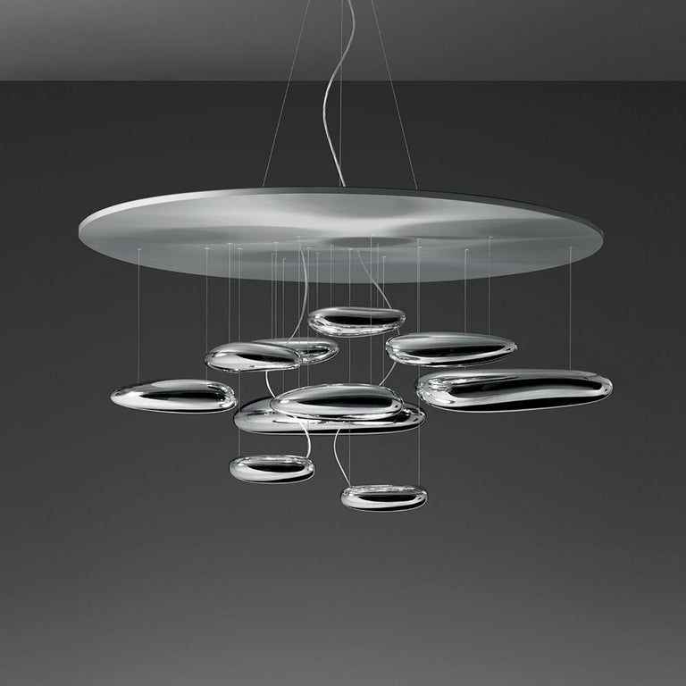"A ""floating"" assembly of pebbles, Ross Lovegrove's Mercury creates a biomorphic relationship between reflected light and its environment. Mini and regular suspension and ceiling versions offered as standard sizes with custom configurations endlessly"