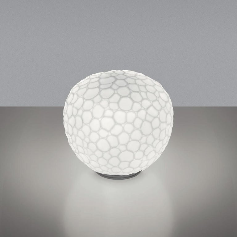 """At once raw and highly finished, Meteorite is an expression of accessible beauty. In the tradition of Venetian battuto (beaten) glass, Pio and Tito Toso designed a special glass-blowing and grinding process allowing an """"unfinished"""" textural feeling."""