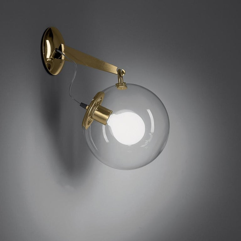 A hand blown glass globe of light on a base and stem of polished chrome. Transparent yet created a softly diffused, dimmable light. A design statement, the Miconos fixture is designed to complement either modern or more traditional interiors. Its