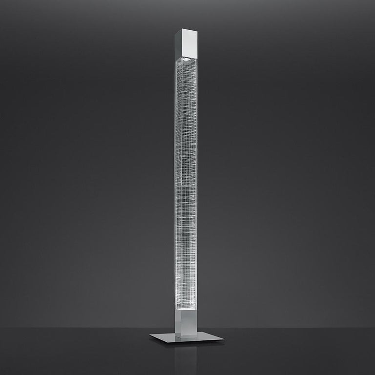 A slim line polished recycled aluminum structure with etched acrylic diffuser, Mimesi creates light in relation to its environment aiming to reduce energy and material usage.  Integrated light source. Only available in the United States.