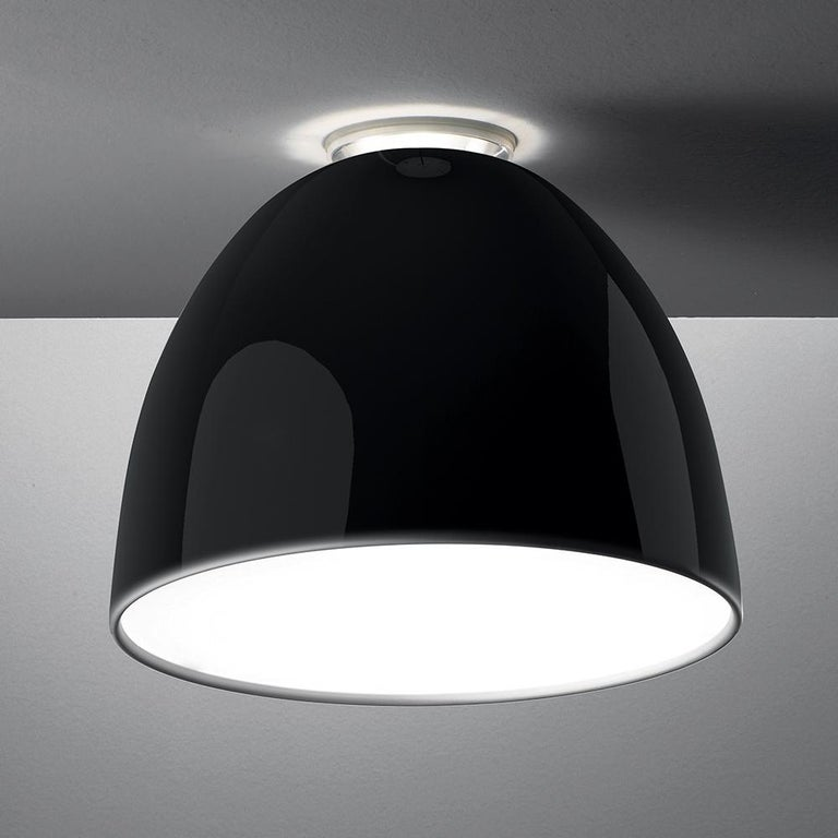 """A system for the metamorphosis of light, Nur creates indirect light accompanied by a subtle """"halo"""" effect on the ceiling.  Aluminum molded body, polycarbonate lower diffuser, upper cap is transparent borosilicate glass.   Nur ceiling is available in"""