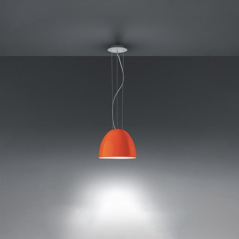 A system for the metamorphosis of light, Nur Suspension has a sleek, contemporary dome shape that provides direct downlighting, with a sanded glass top that also allows a softer, more subtle diffused light to escape.  Nur creates indirect light