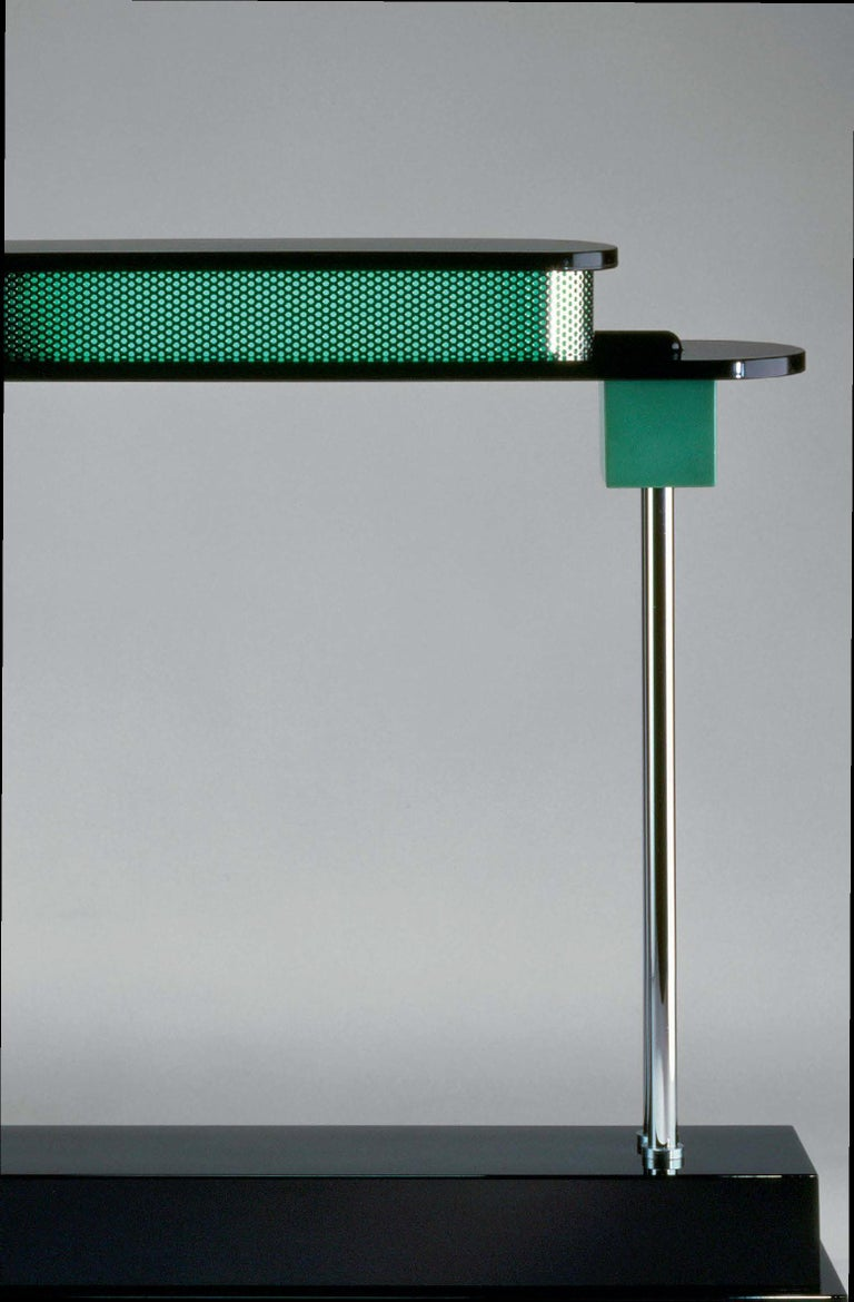 Artemide Pausania LED table lamp in black and green by Ettore Sottsass.   The godfather of contemporary Italian design, Ettore Sottsass believed products should be as sensual as functional. Trained as an architect, Sottsass was a founding member of