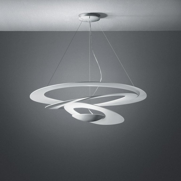 Spirals gently descend delivering sculptural light effects. Painted aluminum body in white or black. Full size, mini and micro for wall, ceiling and suspension.  Integrated light source. Only available in the United States.
