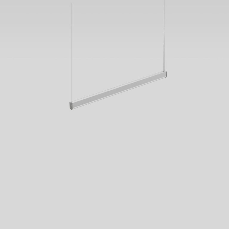 Simple LED suspension lighting with steel cables for direct or direct or indirect lighting.  The body is constructed of extruded aluminium with a clear, anodized matte finish and aluminium end caps in a grey powder coat finish.  The diffuser is made