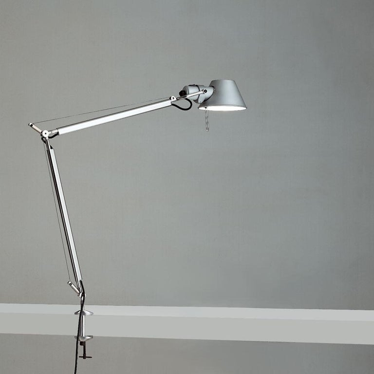 """""""No desk lamp should make you use two hands to position it."""" - Michele De Lucchi. A study in balance and movement, the Tolomeo table lamp is designed for a fully adjustable direction of light. Created for Artemide in 1987 by Michele De Lucchi and"""