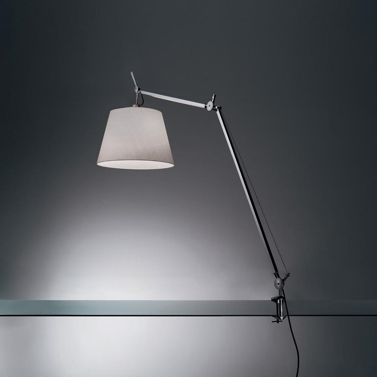 An extension to the iconic Tolomeo family, Tolomeo Mega features the same arm balancing system as the Tolomeo table lamp combined with a selection of parchment or fabric shades, creating its own sub-family. Tolomeo is available in table clamp,