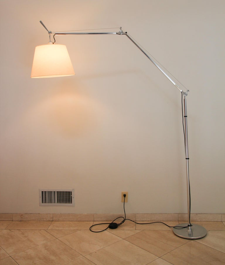 Iconic Tolomeo mega features the same arm balancing system as the Tolomeo table lamp combined with a parchment shade. The light floor lamp with swing arm The Tolomeo Mega Floor Lamp designed by Michele De Lucchi composed of an extruded Aluminum and