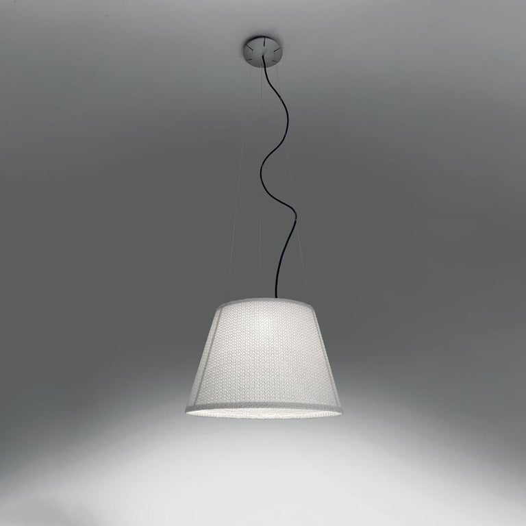 """""""The Tolomeo family is expanded to include a new outdoor product. The light source is enclosed in a diffusing cap fitted inside a transparent IP65 plastic unit that recalls old lampposts, in use when light was produced from oil. The structural"""