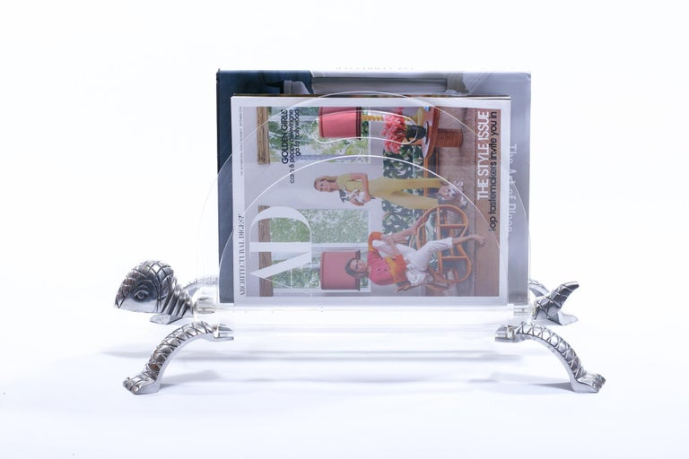 Lucite and aluminum turtle magazine rack, circa 1970s. Charming and Whimsical Turtle with metal head, legs and tail and a Lucite body. Would make a great gift or a decorative addition that has personality as well as function.