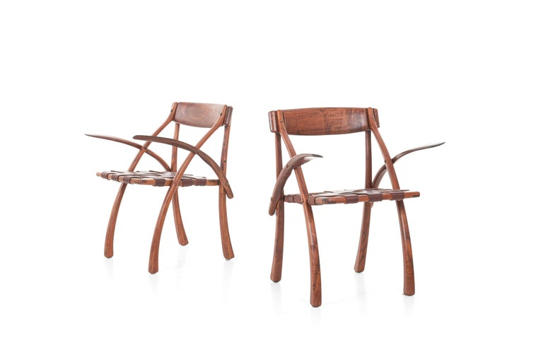 Set of 6 Arthur Espenet Carpenter, (American, 1920-2006) Rare wishbone armchairs, 1980 Cantilever arms in walnut with brown leather with brass grommets Each incised to the underside: Espenet/ 8010/ 2.
