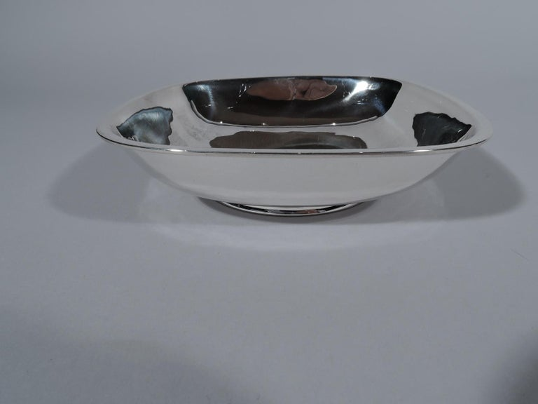 Modern sterling silver bowl. Handmade by Arthur Stone in Gardner, Mass. Squarish with 4 fluidly curved and tapering sides, and flat rim. Round foot ring. Fully marked including maker's stamp and craftsman's initial G for Herman W. Glendenning (fl.