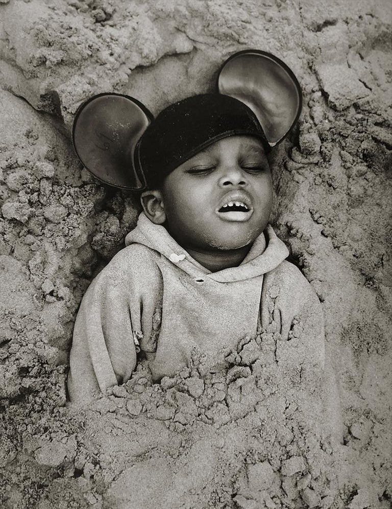 Arthur Tress Black and White Photograph - Boy in Mickey Mouse Hat, Coney Island, New York