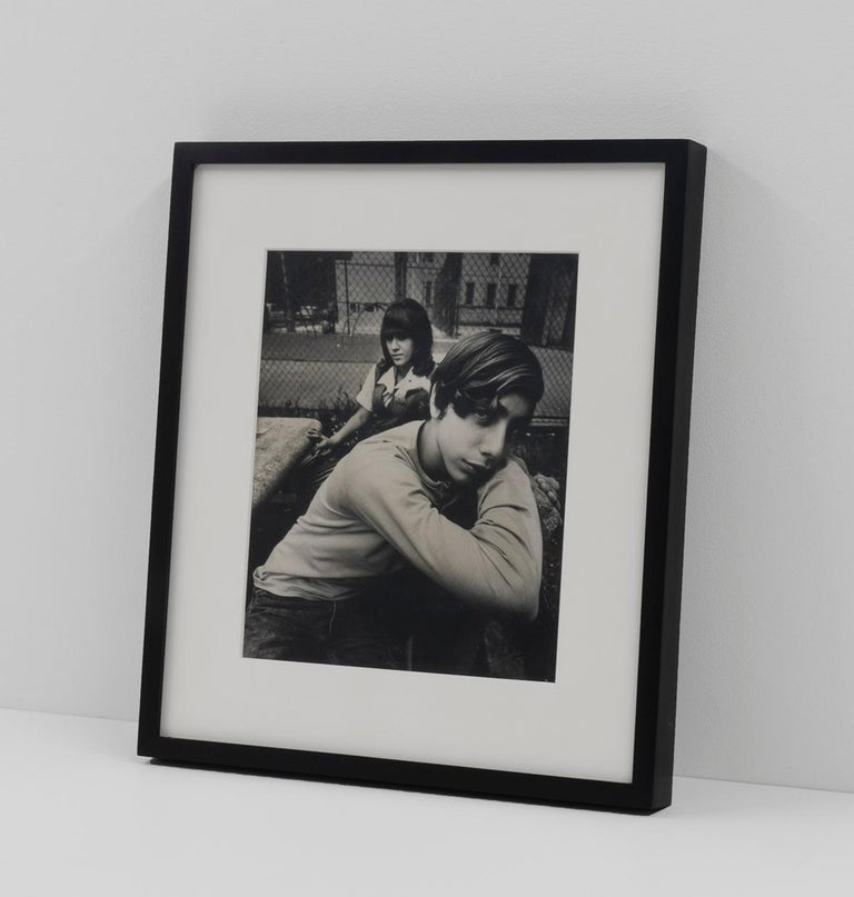Two Teenagers in a Housing Project Park New York, NY 1971  Studio stamp in black ink, verso  Vintage gelatin silver print  9 x 7.5 inches, image 14 x 12.5 inches, framed  Contact gallery for price.  This work is offered by ClampArt in New York City.