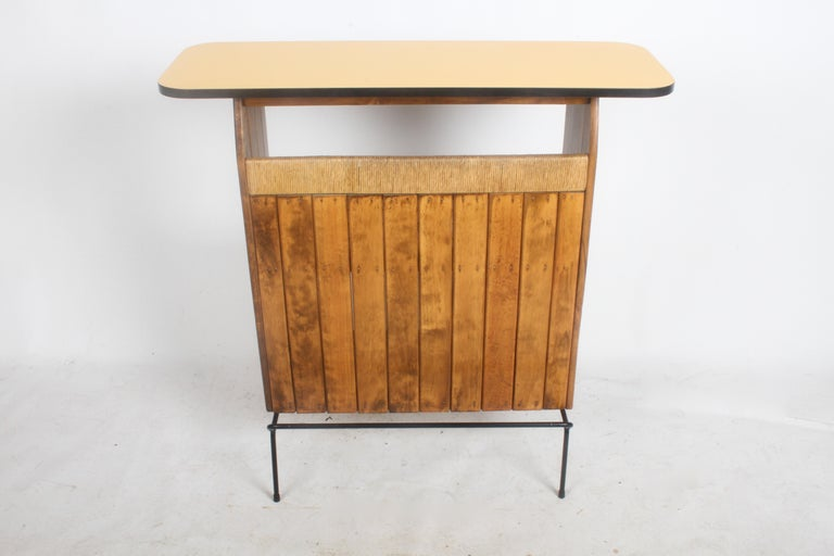 Midcentury Arthur Umanoff bar for Raymor. Wrought iron base, oak slats, rush and Formica top. Overall nice original condition, oak restored, wrought iron base repainted, top in very nice condition, no issues. Top surface is 15