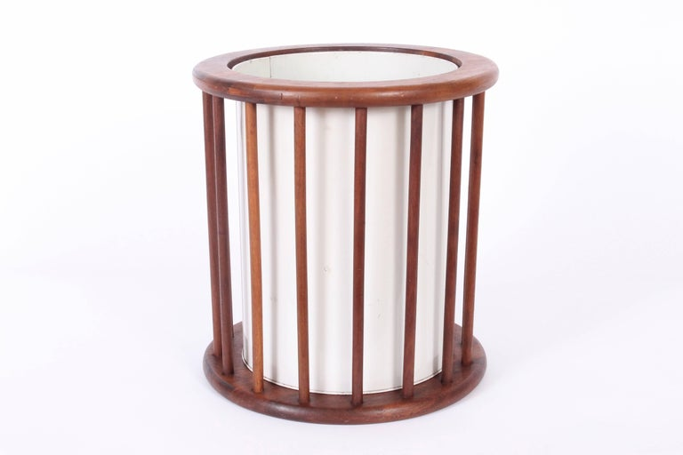 American Mid Century Modern Arthur Umanoff Walnut Spindle Paper Can, Trash Basket. Circular Walnut spindle surround with Off-White enameled liner can for easy removal. Original condition. Versatile. Sculptural. Rarity. Metal container 9D.