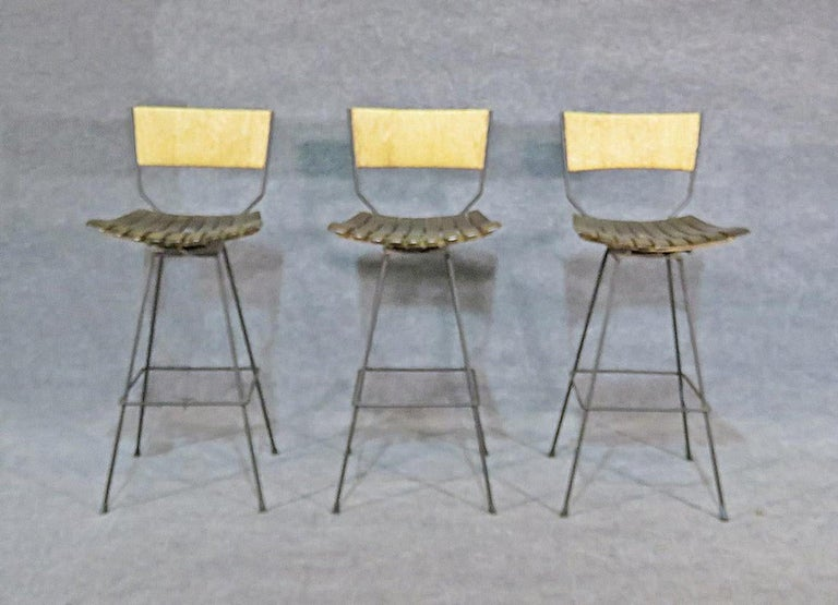 Mid-Century Modern slat stools with rush backs.