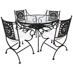 Arthur Umanoff Wrought Iron Sun Table and Four Chairs