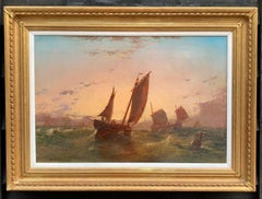 Antique English 19th century oil of fishing boats at sea, with the sun setting