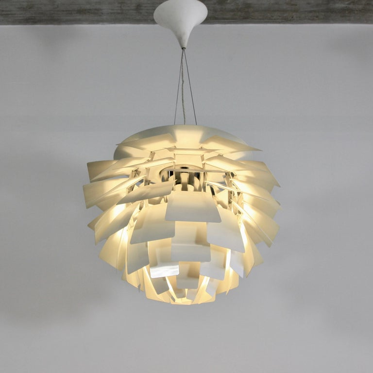 Pendant lampdesigned by Poul Henningsen. Denmark, Louis Poulsen, 20th century .   The Artichoke lamp with 72 white coloured metal blades on chromed steel frame. Vintage lamp in very good condition. Originally designed for the Langelinie Paviolion
