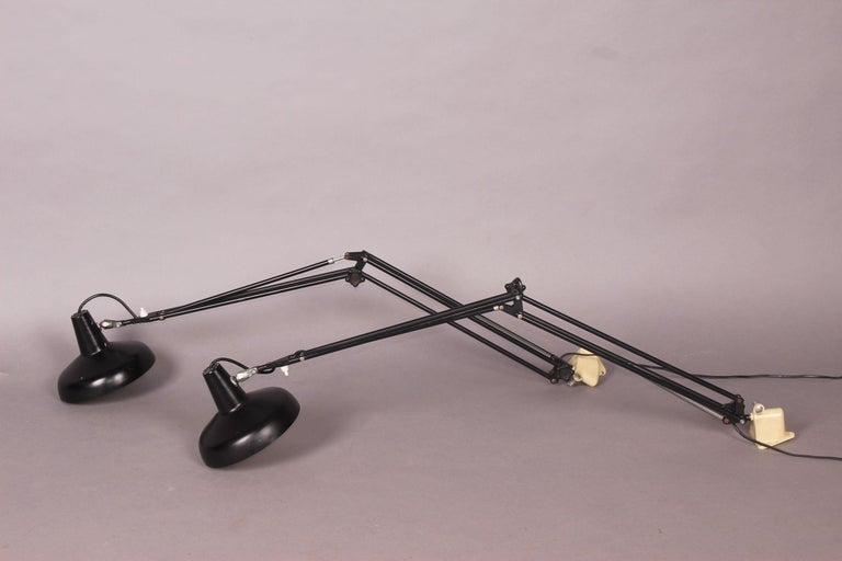 Articulated pair of wall sconces.