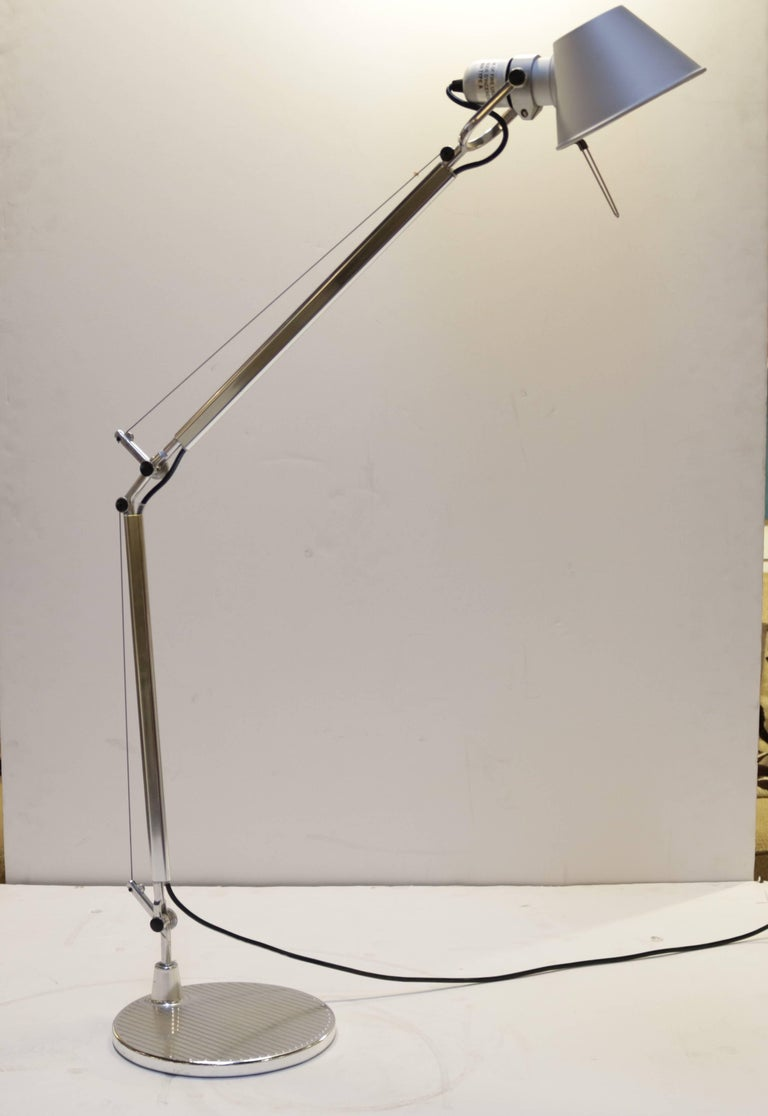 """Designed by Italian designer Michele De Lucchi in 1987, this stream-lined desk or floor reading lamp won the Compasso D'Oro Industrial Design award in 1989. It is die-cast aluminium with steel cables.  The shade measures 5.75"""" in diameter and as"""