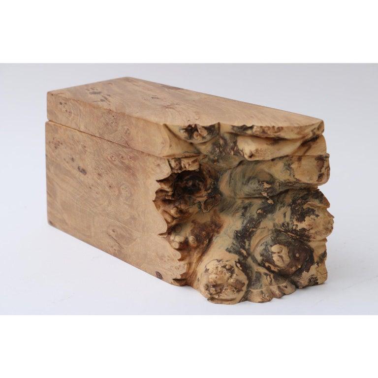 This stylish, organic burl wood box was created by the American artisan Michael Elkan.
