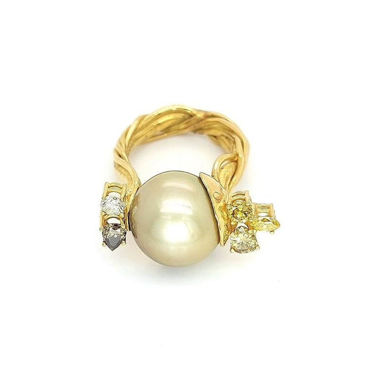 De Saedeleer 18 Kt Yellow Gold Tahiti Pearl & Diamonds Ring  One of a kind Jean Pierre De Saedeleer hand crafted ring.  Only one piece made which makes it so unique  !  Diamond: Fancy & white diamonds ,together ca. 1.22 Cts  Pearl: Tahiti 14.50