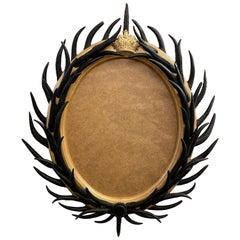 Artisan Designed Dark Antler Oval Mirror with a Crown Motif