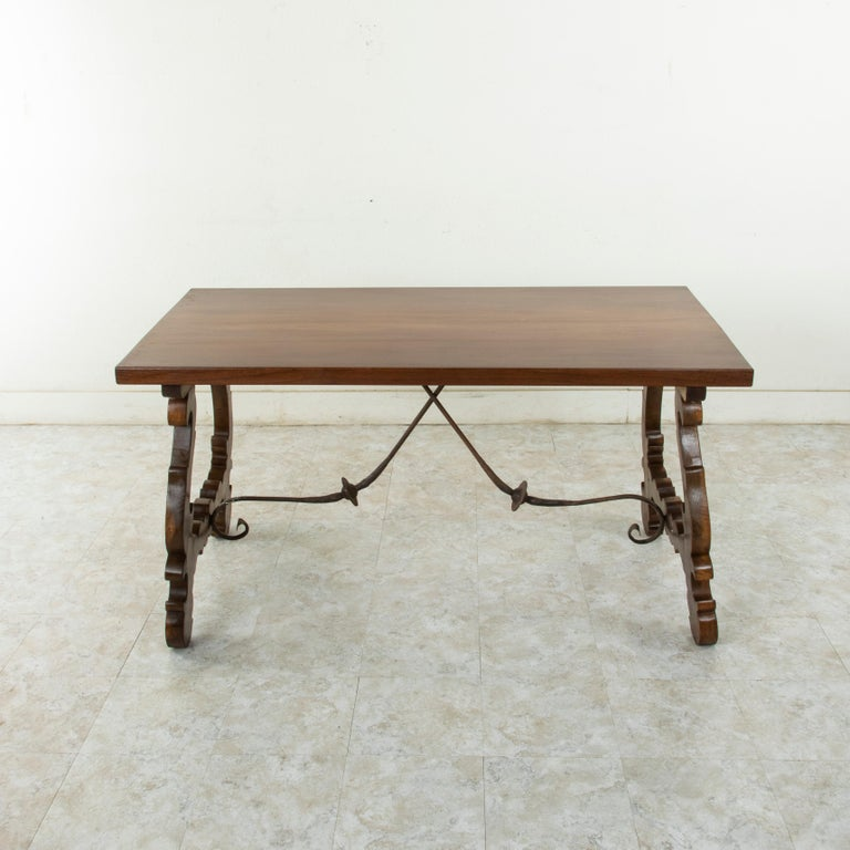 This beautiful artisan-made Spanish Renaissance style table or writing desk from the turn of the twentieth century features a solid amaranth or purple heart top made from a single plank with a width of 31.5 inches. A rare species of wood, the